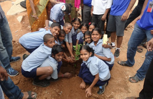 Children planting trees in India