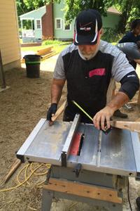 Verizon employee volunteering for Habitat for Humanity