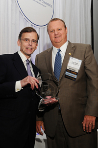 Verizon's Doug Brammer (left) receives the Sustainability Award on behalf of Verizon from Mr. Mark Moore, executive vice president of John Marshall Bank and former Chairman of the Board of the Fairfax County Chamber of Commerce.
