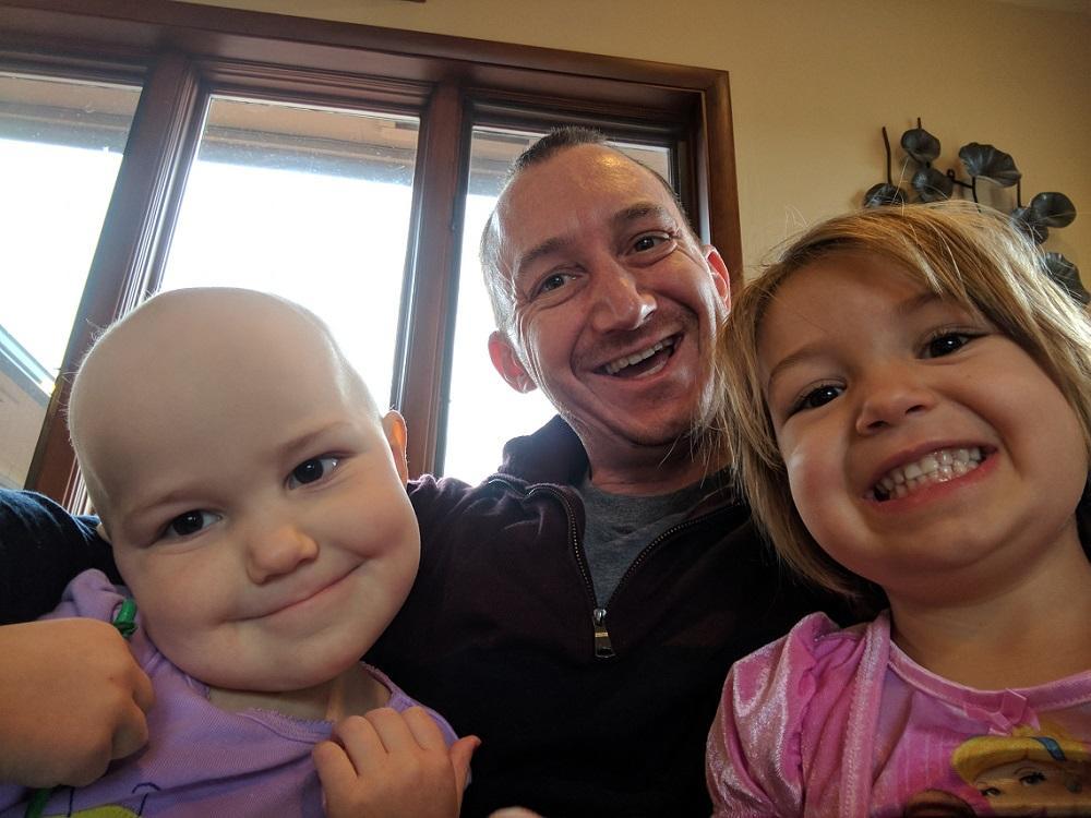 Arden, her father, Justin, and her older sister, Violet.