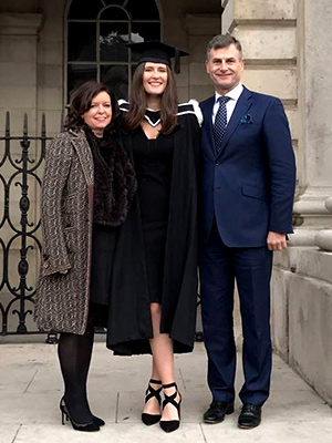Ronan poses with his daughter, Charlotte for her graduation