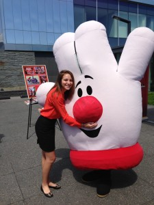 General Mills intern Stacy Hauersperger mugging with Hamburger Helper mascot