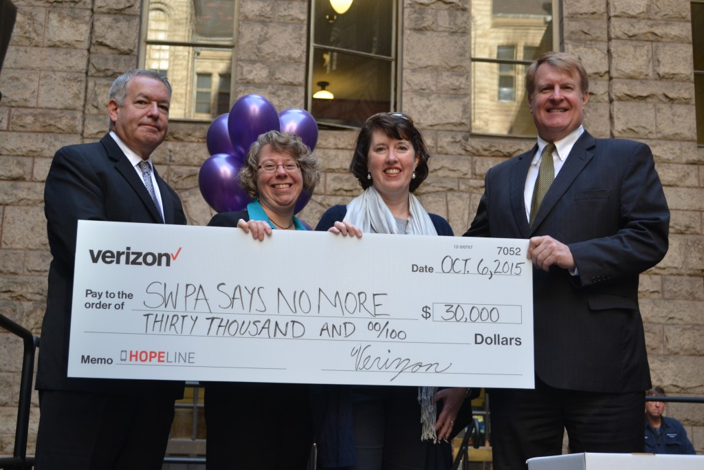 Verizon presents Southwest PA Says No More with a $30,000 grant at the Verizon HopeLine phone drive.