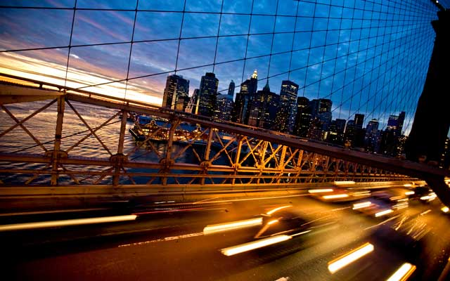 Traffic zooming along the Brooklyn Bridge in lower Manhattan