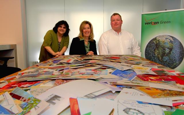 Verizon Green team members Barbera Frances, Deb Shugard and Wilmer Johnson help collect used greeting cards.