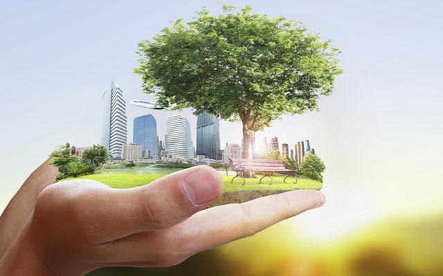 Green community held in hand