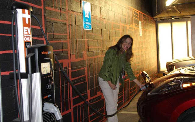 Verizon Green Team member Maggie Sullivan, charging her 2015 Nissan Leaf (affectionately named Lucy) while visiting the Verizon Green Expo in Irving, Texas on Earth Day.