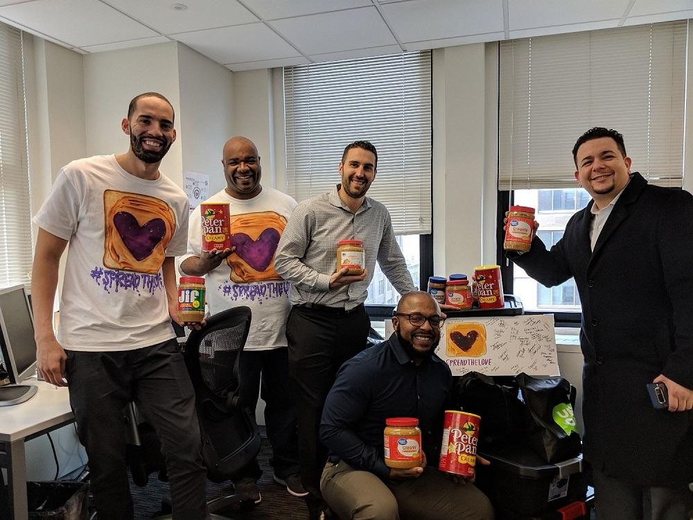 Charlotte and NYC teams pose with their PBJ sandwiches