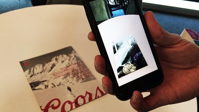 Readers hover their smartphone cameras over the cover of a recent Sports Illustrated magazine to see it come to life using augmented reality