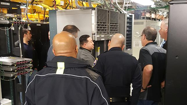 Safety officials get up close and personal with the workings of a wireless switch location