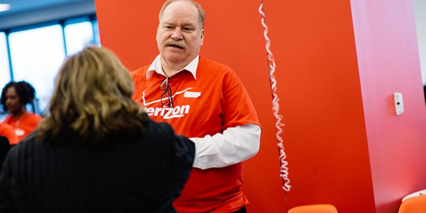 Verizon representatives get a chance to interact with potential employees.