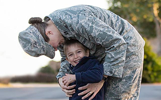 Military woman with child