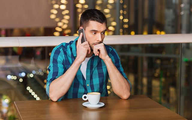 Man worried on mobile phone