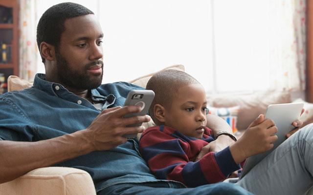Father and son on mobile phones