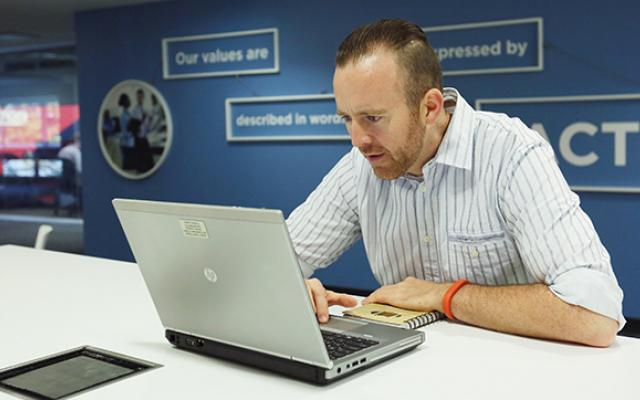 Photo of man taking an online course
