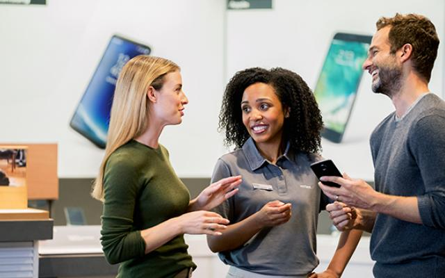 Verizon sales person with customers