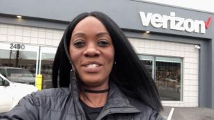 image of a female employee in front of a wireless store