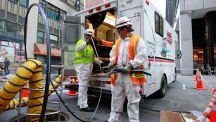 Verizon technicians install fiber-optic cable in lower Manhattan. (Mark Von Holden/AP Images for Verizon)