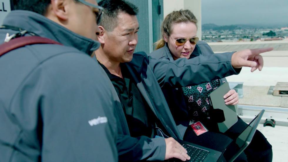 Image of Verizon employee Irene Hukkelhoven and network engineers.