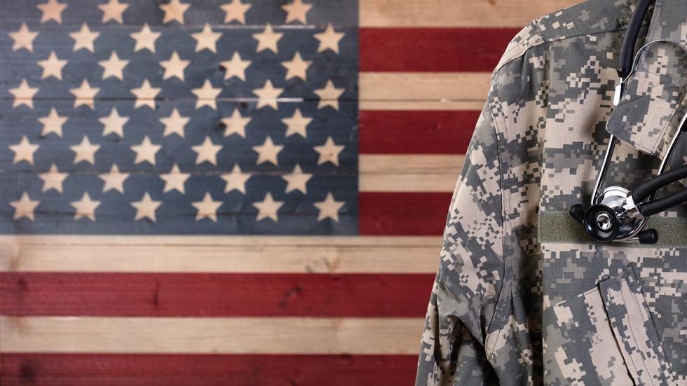 Military doctor in front of U.S. flag