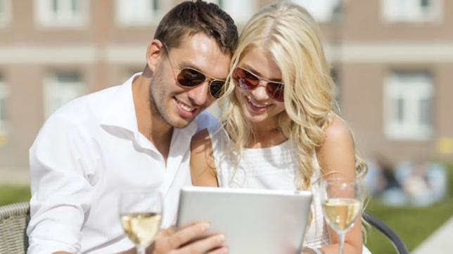 Couple watching a tablet