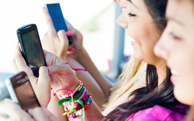 Teen girls on smartphones