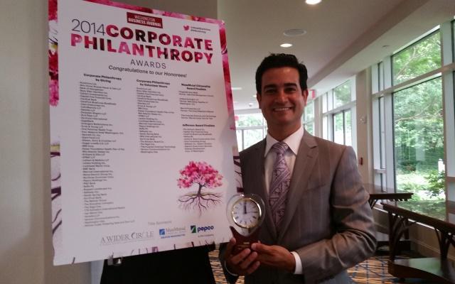 Verizon's Mario Acosta-Velez receiving the 2014 Corporate Philanthropy Award