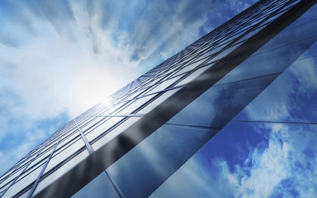 Sun over skyscraper