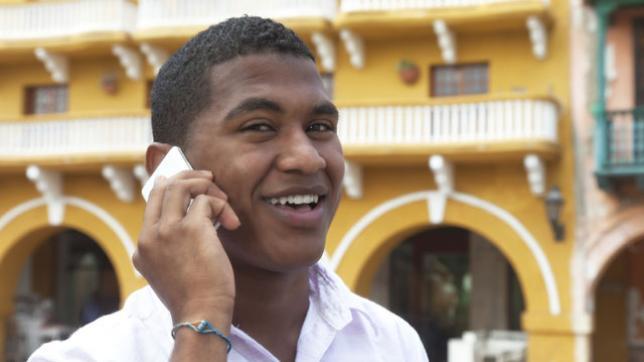 Cuban man on phone
