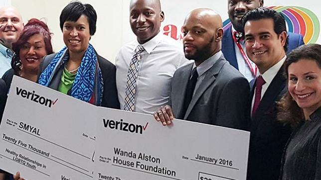 Washington, DC mayor Muriel Bowser, second from left, and Mario Acosta-Velez, second from right, present grant checks to Sultan Shakir from SMYAL and Ken Pettigrew from Wanda Alston House in Washington, DC.