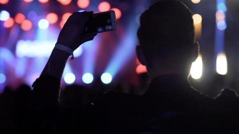 Man dancing at concert video
