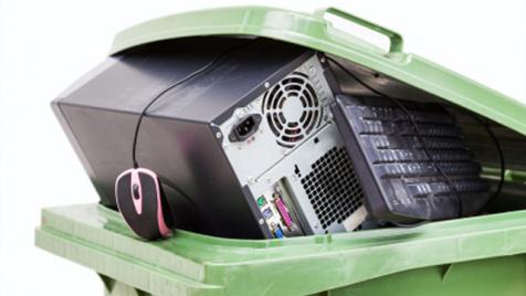 Old electronic hardware in recycling bin