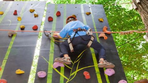 Climbing a wall at summer camp