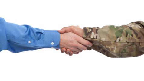 Businessman and military handshake