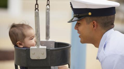 Military Serviceman with child