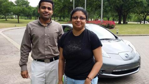 Verizon employees Prasanth Kalvettukuzhiyil and Madhubhashini Dhanabalan test drive the 2015 Nissan Leaf
