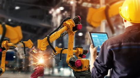Man with Manufacturing Robot