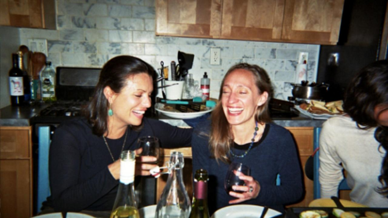 Women laughing at kitchen table