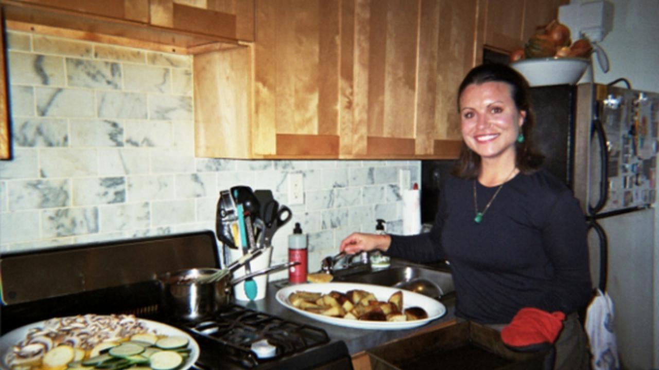 Woman at stove cooking