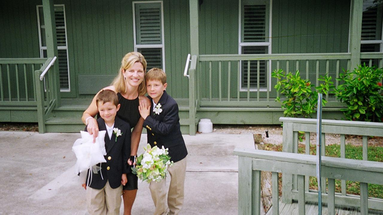 Nancy Clark poses with her two sons.
