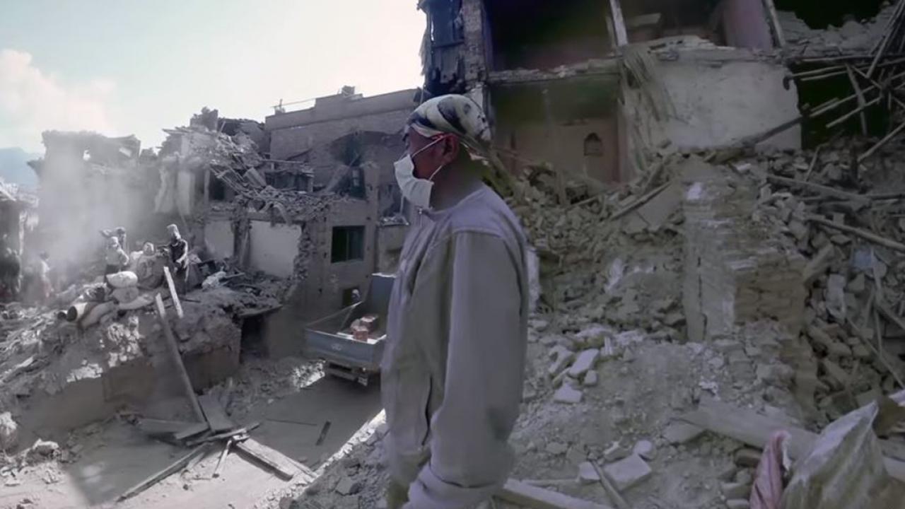 Man standing amongst the ruins