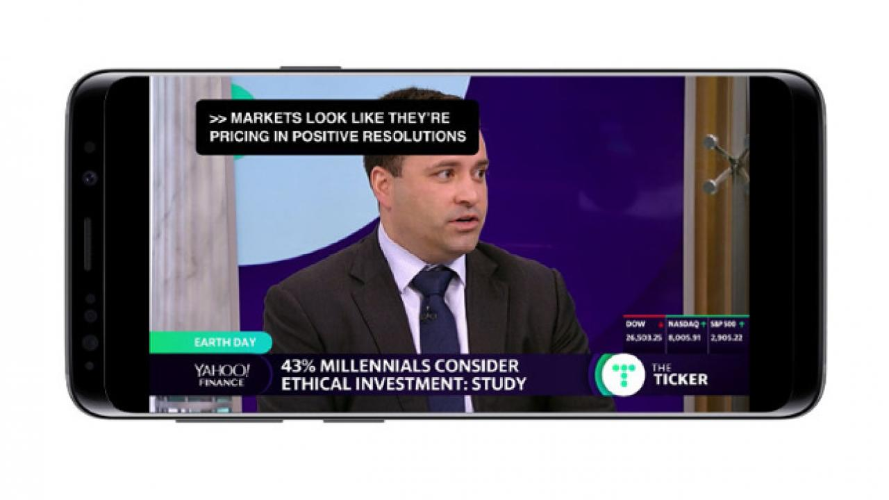 An Android phone showing the accessible Yahoo Finance app,