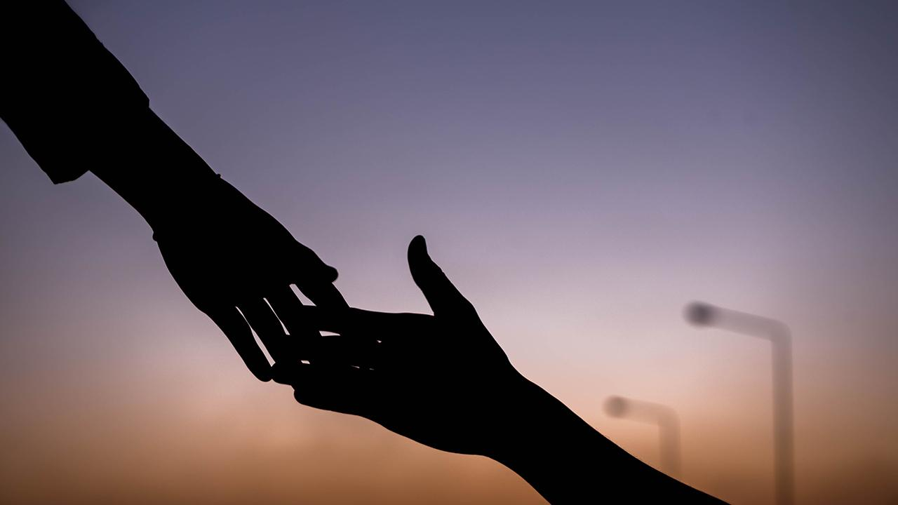 Hand reaching out to help