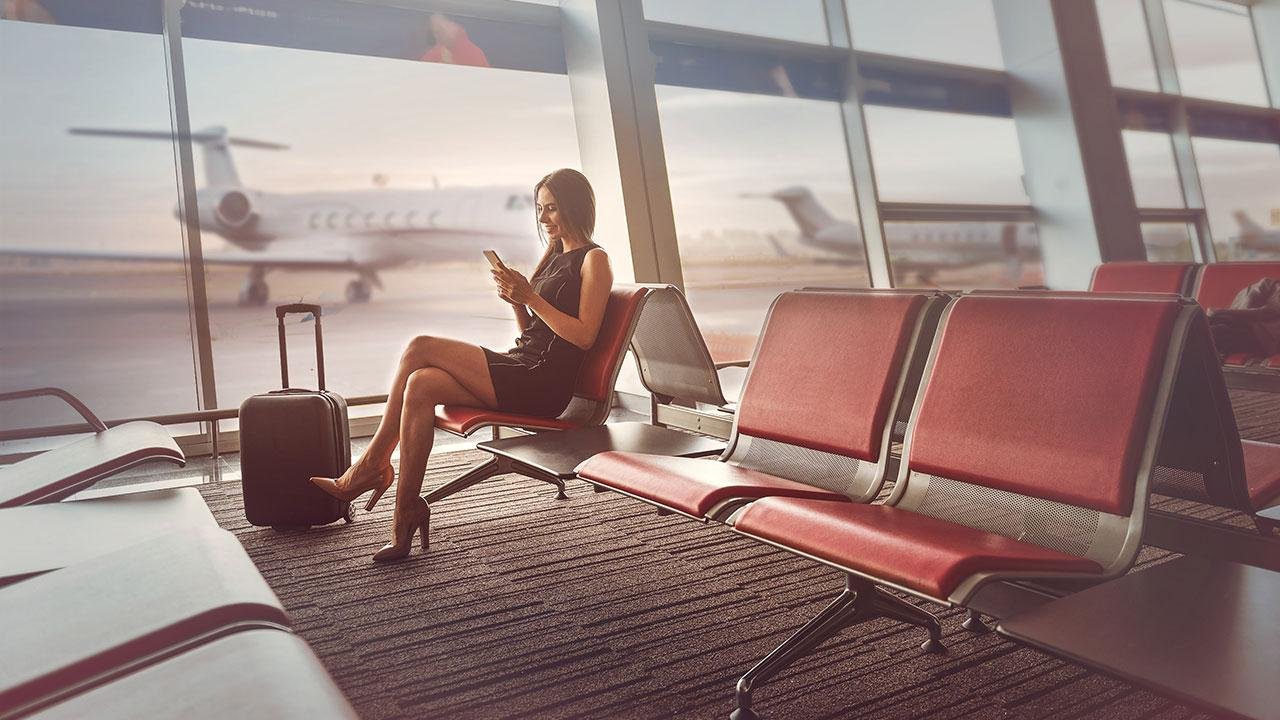 Woman on mobile at airport