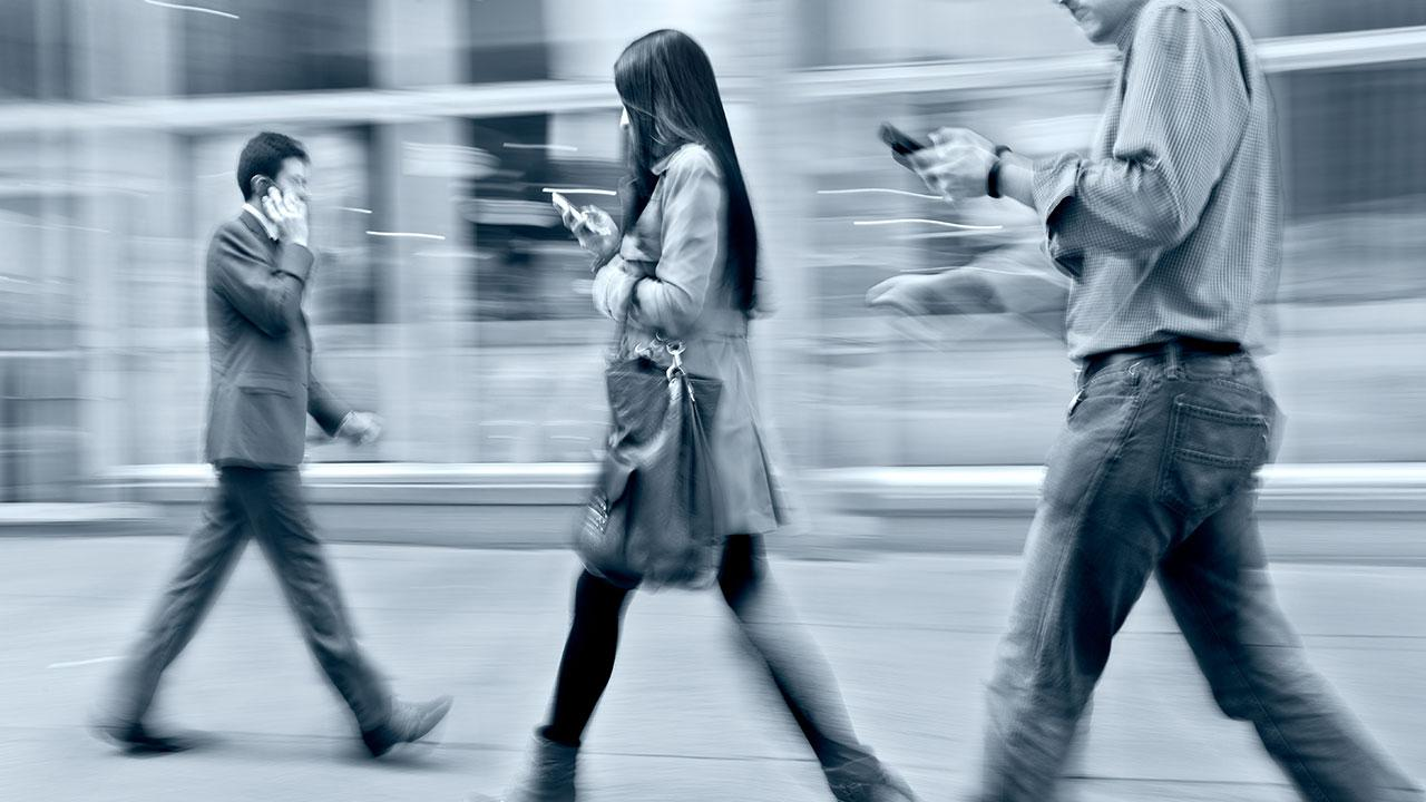 Crowd walking with their cell phones