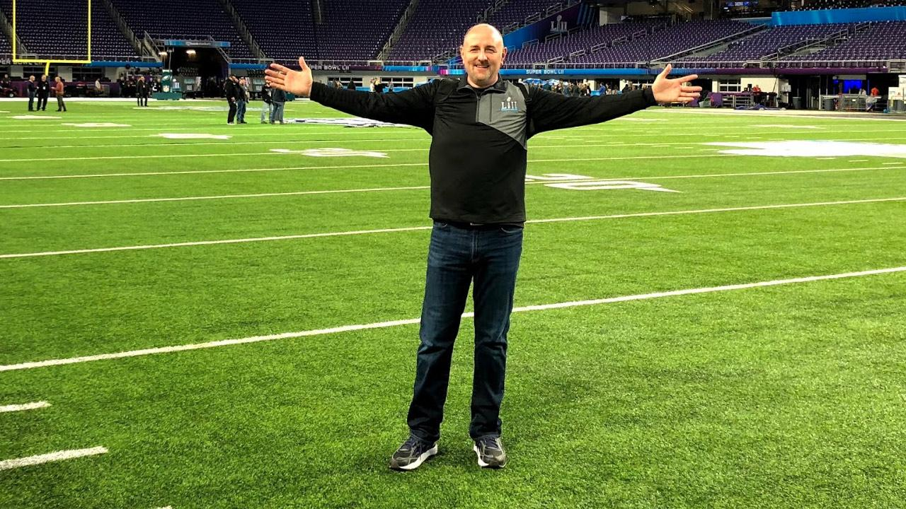 Image of Brian Mecum standing on the field at US Bank stadium.