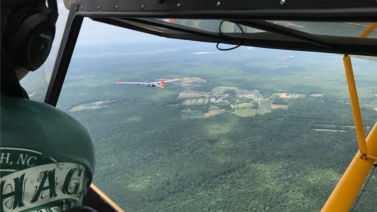 Chase plane follows drone
