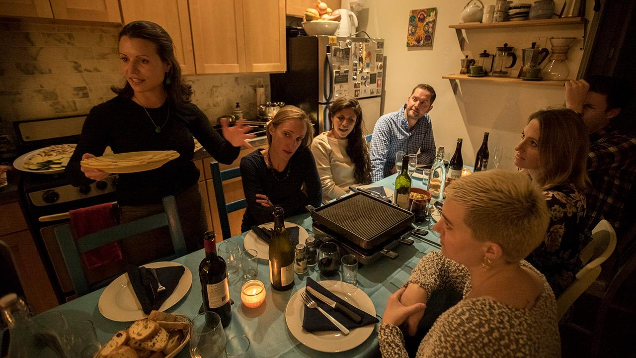 People eating at kitchen table