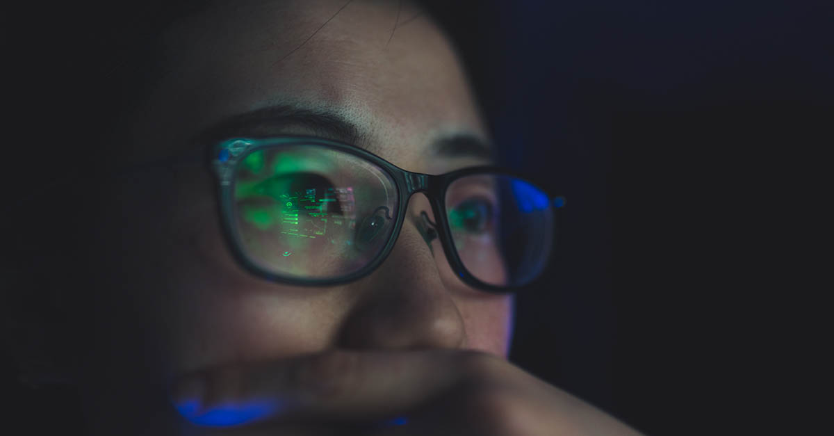 Close up of a woman in glasses