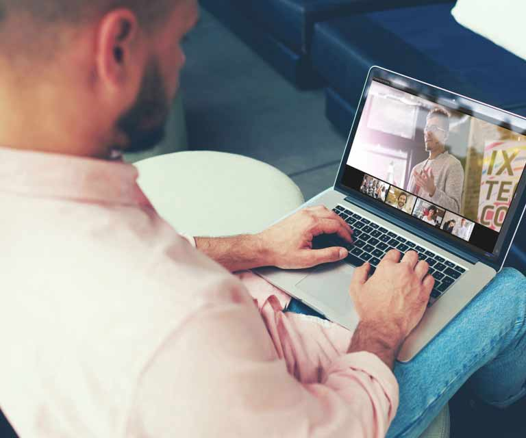 Man joining a video conference on his laptop